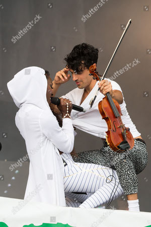 Singer Elisabeth Troy and Neil Amin-Smith of the band Clean Bandit perform on the Pyramid Stage at Glastonbury music festival on at Worthy Farm, Glastonbury, England