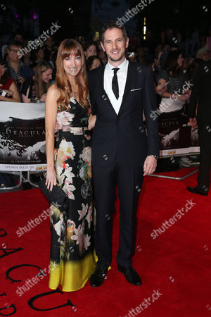 Director Gary Shore, right, and his wife Ciara pose for photographers as they arrive for the premiere of the film Dracula Untold in central London