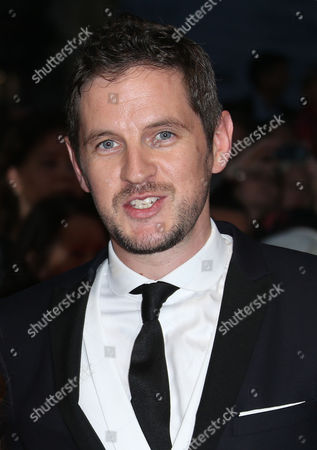Director Gary Shore poses for photographers as they arrive for the premiere of the film Dracula Untold in central London