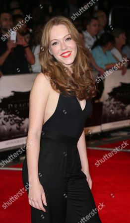 Amy Nuttall poses for photographers as they arrive for the premiere of the film Dracula Untold in central London