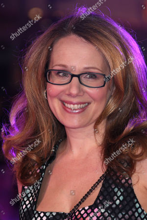 Dana Fox poses for photographers upon arrival at the premiere of the film 'How To Be Single' in London