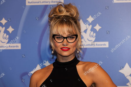 Singer Kimberley Wyatt poses for photographers upon arrival at the National Lottery Awards, in central London