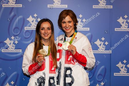 Olympic Medalists Elena Barker, left, and Joanna Rowsell Shand pose for photographers upon arrival at the National Lottery Awards, in central London