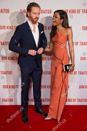 Actors Damian Lewis and Naomie Harris chat to one another before they pose for photographers upon arrival at the UK Gala Premiere of Our Kind Of Traitor, at a central London hotel