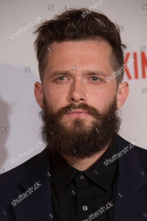 Actor Grigoriy Dobrygin poses for photographers upon arrival at the screening of the UK Gala Premiere of Our Kind Of Traitor, at a central London hotel