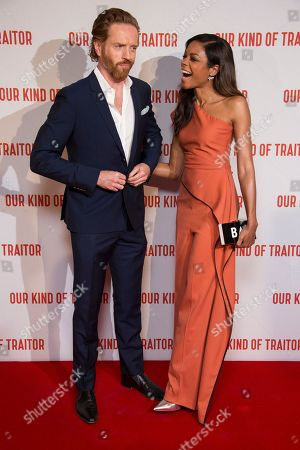 Actors Damian Lewis and Naomie Harris react as they pose for photographers upon arrival at the UK Gala Premiere of Our Kind Of Traitor, at a central London hotel