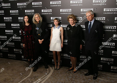 From left, actress Yao Chen, photographer Annie Leibovitz, writer Tavi Gevinson, philanthropist Agnes Gund and chairman and chief executive officer of Pirelli Marco Tronchetti pose for photographers upon arrival for the Pirelli Calendar 2016 launch at the Grosvenor Hotel Ballroom in London