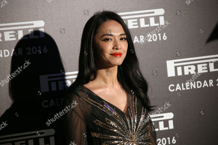 Yao Chen poses for photographers upon arrival at the launch of the Pirelli Calendar 2016 launch in London