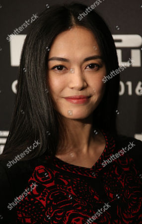 Yao Chen poses for photographers upon arrival for the Pirelli Calendar 2016 launch at the Grosvenor Hotel Ballroom in London