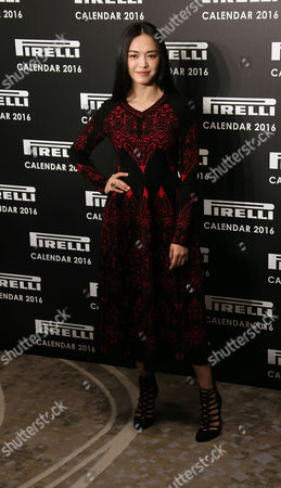 Actress Yao Chen poses for photographers upon arrival for the Pirelli Calendar 2016 launch at the Grosvenor Hotel Ballroom in London