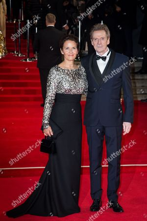 Tove Bornhoeft and Jesper Christensen pose for photographers upon arrival at the world premiere of the latest James Bond film, 'Spectre' in London