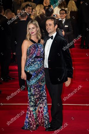 Marissa Hermer and Matt Hermer pose for photographers upon arrival at the world premiere of the latest James Bond film, 'Spectre' in London