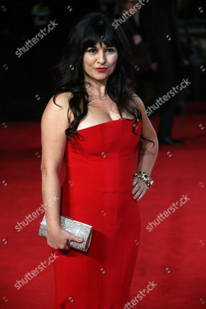 Actress Maddalena Ischiale poses for photographers upon arrival at the premiere of the film Unbroken in London