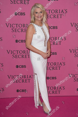 Sharen Turney poses for photographers upon arrival at the Victoria's Secret fashion show in London