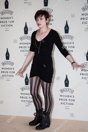 Laurie Penny poses for photographers upon arrival at the Baileys Women's Prize for Fiction Awards Ceremony in London