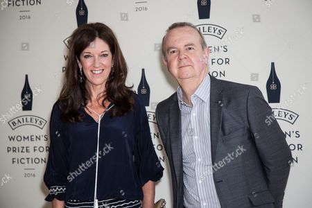 Victoria Hislop and Ian Hislop pose for photographers upon arrival at the Baileys Women's Prize for Fiction Awards Ceremony in London