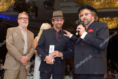 Vic Reeves, David Peacock and Charles Hodges attend the Nordoff Robbins O2 Silver Clef Awards 2014 at the Hilton Hotel in London on
