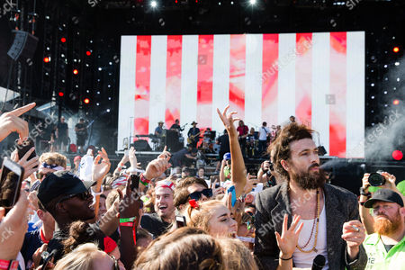 Alex Ebert of Edward Sharpe and the Magnetic Zeros mingles with the crowd at The Budweiser Made In America Festival, in Philadelphia
