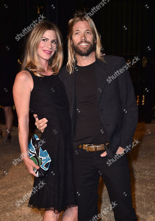 """Alison Hawkins, left and Taylor Hawkins attend Burberry's """"London in Los Angeles"""" event at the Griffith Observatory on"""