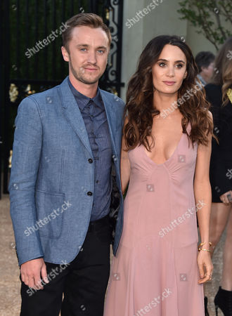 """Tom Felton, left and Jade Olivia attend Burberry's """"London in Los Angeles"""" event at the Griffith Observatory on"""