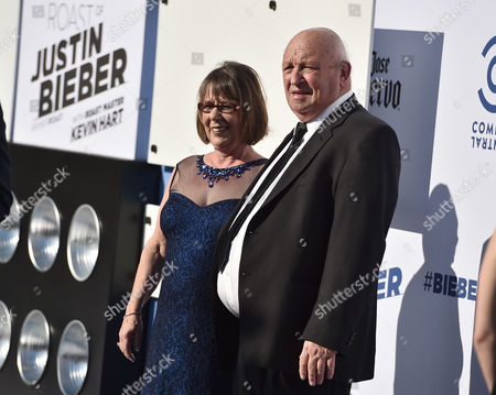 Stock Image of Diane Dale, left, and Bruce Dale arrive at the Comedy Central Roast of Justin Bieber at Sony Pictures Studios, in Culver City, Calif