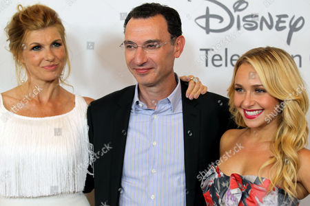 Paul Lee, president of ABC Entertainment Group, center, Hayden Panettiere, right, and Connie Britton arrive at the Disney ABC Television Group 2012 Summer Press Tour All-Star Cocktail Reception, in Beverly Hills, Calif