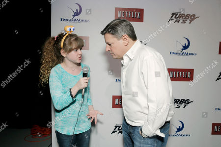 Piper Reese, left, and Ted Sarandos, chief content officer of Netflix, attend DreamWorks Animation and Netflix's Turbo FAST Los Angeles Premiere Event, on in West Hollywood, Calif
