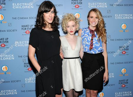 """Writer and director Rebecca Thomas, left, and actresses Julia Garner, center, and Cassidy Gard attend a special screening of """"Electrick Children"""" hosted by the Cinema Society and Make Up For Ever at the IFC Center on in New York"""