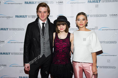 """Eddie Hassell, left, Joey King and Olesya Rulin attend the premiere of """"Family Weekend"""" on in New York"""