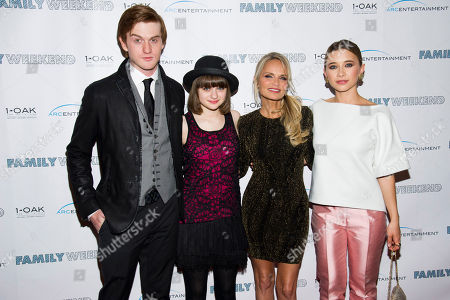 """Eddie Hassell, left, Joey King, Kristin Chenoweth and Olesya Rulin attend the premiere of """"Family Weekend"""" on in New York"""
