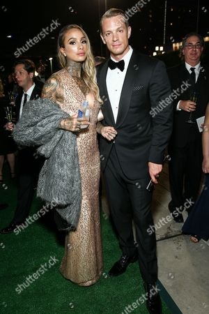 Cleo Wattenstrom, left, and Joel Kinnaman attend Ferrari at the 68th Primetime Emmy Awards Governors Ball held at the L.A. Convention Center, in Los Angeles