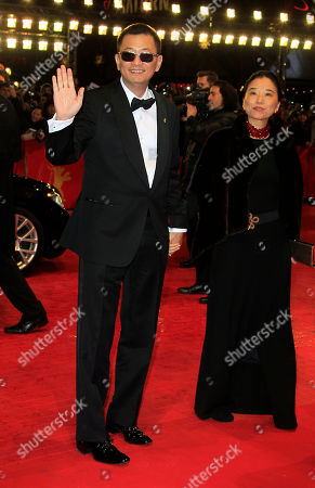 Stock Photo of Director Wong Kar Wai and wife Esther Wong arrive on the red carpet for the screening of the film The Grandmaster at the 63rd edition of the Berlinale, International Film Festival in Berlin, Thursday, Feb.7,2013
