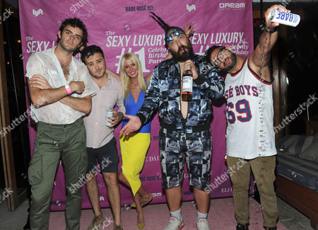 Stock Picture of Rose Boys and White Girl Rose founders, Tanner Cohen, David Oliver Cohen, Fat Jew and Alexander Ferzan, left to right, pose with Tara Reid at the first birthday party for White Girl Rose hosted by Elite Daily at The Dream Downtown, in New York
