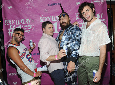 Stock Image of Rose Boys and White Girl Rose founders, Alexander Ferzan, David Oliver Cohen, Fat Jew and Tanner Cohen, left to right, celebrate at the first birthday party for White Girl Rose hosted by Elite Daily at The Dream Downtown, in New York