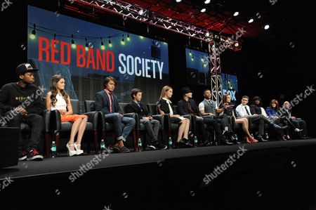 """Astro, from left, Ciara Bravo, Nolan Sotillo, Griffin Gluck, Zoe Levin, Charlie Rowe, Wilson Cruz, Rebecca Rittenhouse, Dave Annable, Octavia Spencer, Writer/Executive Producer Margaret Nagle and Executive Producer Justin Falvey speak on stage during the """"Red Band Society"""" panel at the The FOX 2014 Summer TCA held at the Beverly Hilton Hotel, in Beverly Hills, Calif"""