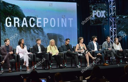 From left, Kevin Zegers, Jessica Lucas, Kevin Rankin, Jacki Weaver, Michael Pena, Virginia Kull, David Tennant, Executive Producer Dan Futterman and Executive Producer Carolyn Bernstein speak on stage during the 'Gracepoint' panel at the The FOX 2014 Summer TCA held at the Beverly Hilton Hotel, in Beverly Hills, Calif