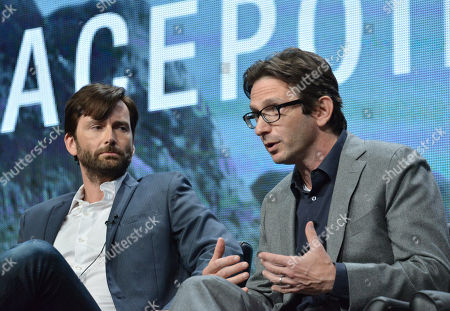 """David Tennant, left, and Executive Producer Dan Futterman speak on stage during the """"Gracepoint"""" panel at the The FOX 2014 Summer TCA held at the Beverly Hilton Hotel, in Beverly Hills, Calif"""