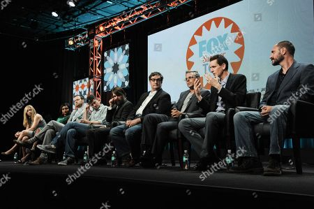 From left, Elizabeth Meriwether, Mindy Kaling, Dan Goor, Michael Schur, Will Forte, Al Jean, Richard Appel, Steve Callaghan, and Loren Bouchard participate onstage during the â?oeBehind The Laughsâ?? panel at the The FOX 2014 Summer TCA held at the Beverly Hilton Hotel, in Beverly Hills, Calif
