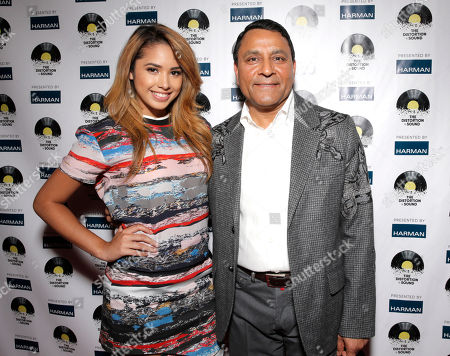 Jasmine Villegas, left, and CEO of Harman Dinesh Paliwal arrive at the Distortion of Sound documentary premiere presented by Harman at the Grammy Museum, in Los Angeles