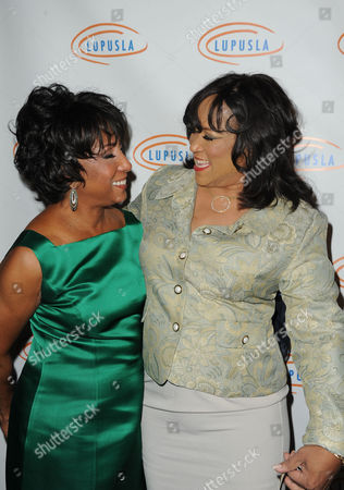 Carolyn Folks, at left, and Jackee Harry attend Lupus LA's Hollywood Bag Ladies Luncheon at the Beverly Wilshire Hotel, in Beverly Hills, Calif