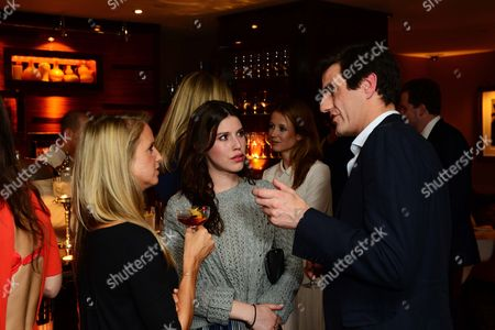 Lily Lewis (c) and guests seen at Johnnie Walker Blue Label Dinner at China Tang, The Dorchester on Wednesday, May, 15, 3013 in London