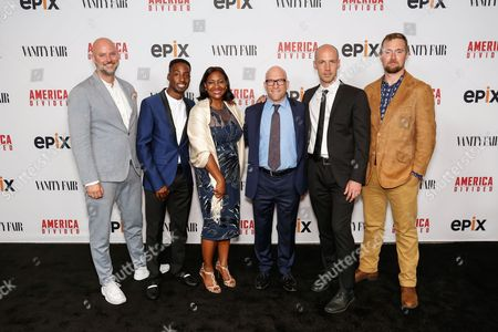 """Stock Photo of Dave O'Connor, from left, Justin Talley, Lajun Montgomery Tabron, Solly Granatstein, Richard Rowley, and Lucian Read arrive at the LA Premiere of """"America Divided"""" at The Billy Wilder Theater, in Westwood, Calif"""