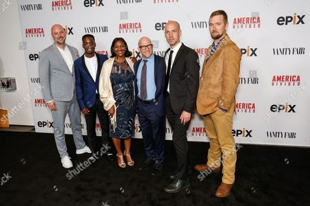 """Stock Picture of Dave O'Connor, from left, Justin Talley, Lajun Montgomery Tabron, Solly Granatstein, Richard Rowley, and Lucian Read arrive at the LA Premiere of """"America Divided"""" at The Billy Wilder Theater, in Westwood, Calif"""