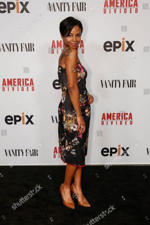 """Aasha Davis arrives at the LA Premiere of """"America Divided"""" at The Billy Wilder Theater, in Westwood, Calif"""