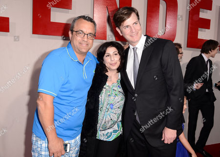 """Stock Image of From left, producer Jack Giarraputo, Sue Kroll, president of worldwide marketing and international distribution for Warner Bros., and producer Mike Karz arrive at the LA Premiere of """"Blended"""" at the TCL Chinese Theatre, in Los Angeles"""