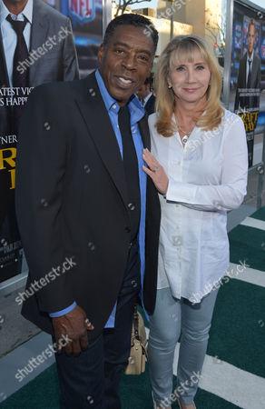 "Ernie Hudson, left, and Linda Kingsberg arrive at the premiere of ""Draft Day"" at The Regency Village Theatre, in Westwood, Calif"