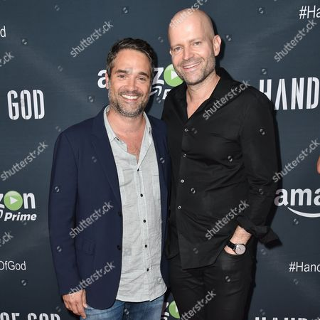 """Morgan Wandell, left, and Marc Forster arrive at the Premiere of """"Hand of God"""" held at the Ace Hotel, in Los Angeles"""