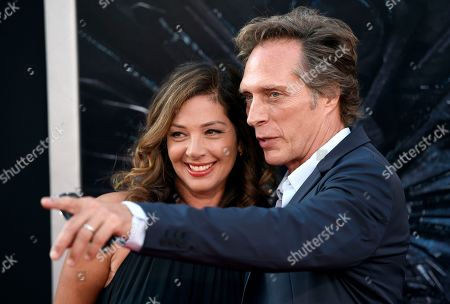 """Kymberly Kalil, left, and William Fichtner arrive at the premiere of """"Independence Day: Resurgence"""" at the TCL Chinese Theatre, in Los Angeles"""