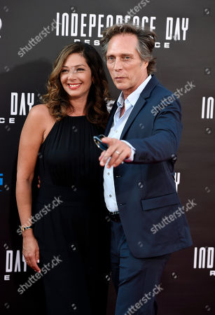 """William Fichtner, a cast member in """"Independence Day: Resurgence,"""" poses with his wife Kymberly Kalil at the premiere of the film at the TCL Chinese Theatre, in Los Angeles"""