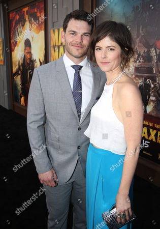 """Josh Helman, left, and Jennifer Allcott arrive at the Los Angeles premiere of """"Mad Max: Fury Road"""" at the TCL Chinese Theatre on"""